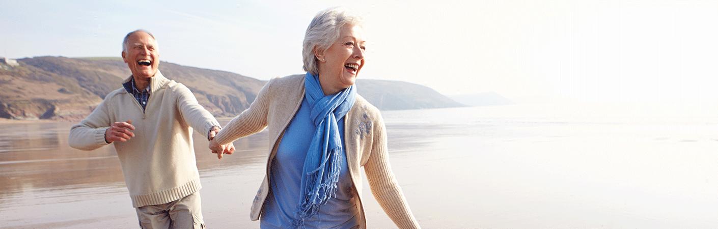 Elderly couple enjoying a stroll on the beach
