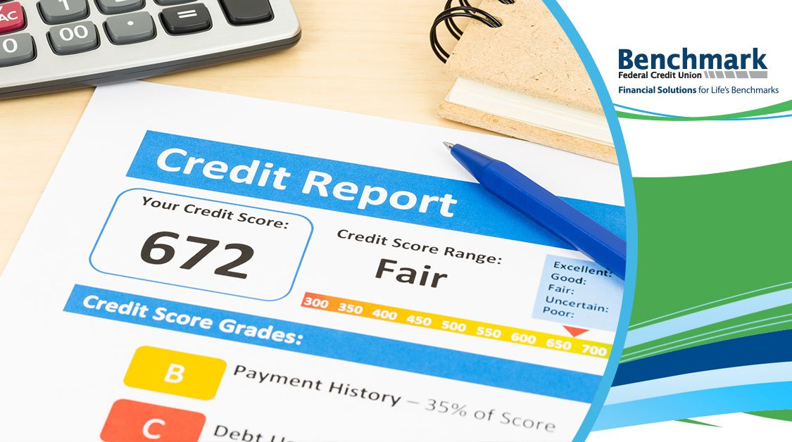 Credit score sitting on a desk with a 672 rating.