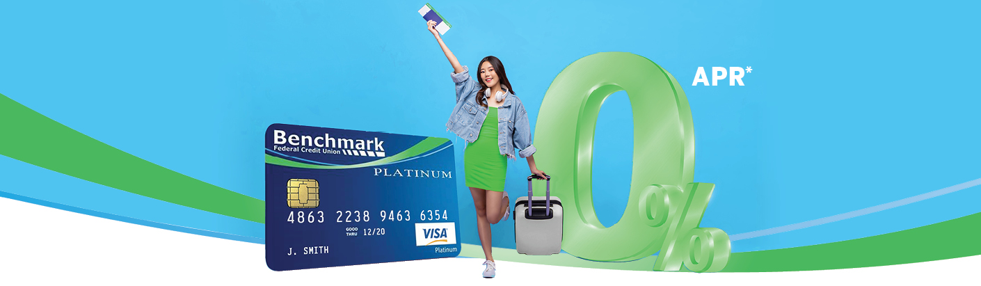 Woman standing next to a large Benchmark visa credit card and 0% symbol.